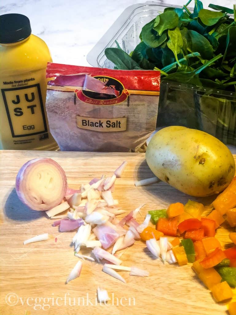 ingredients for vegan breakfast scramble including Just Egg, black salt, shallot, bell peppers, potato, and spinach