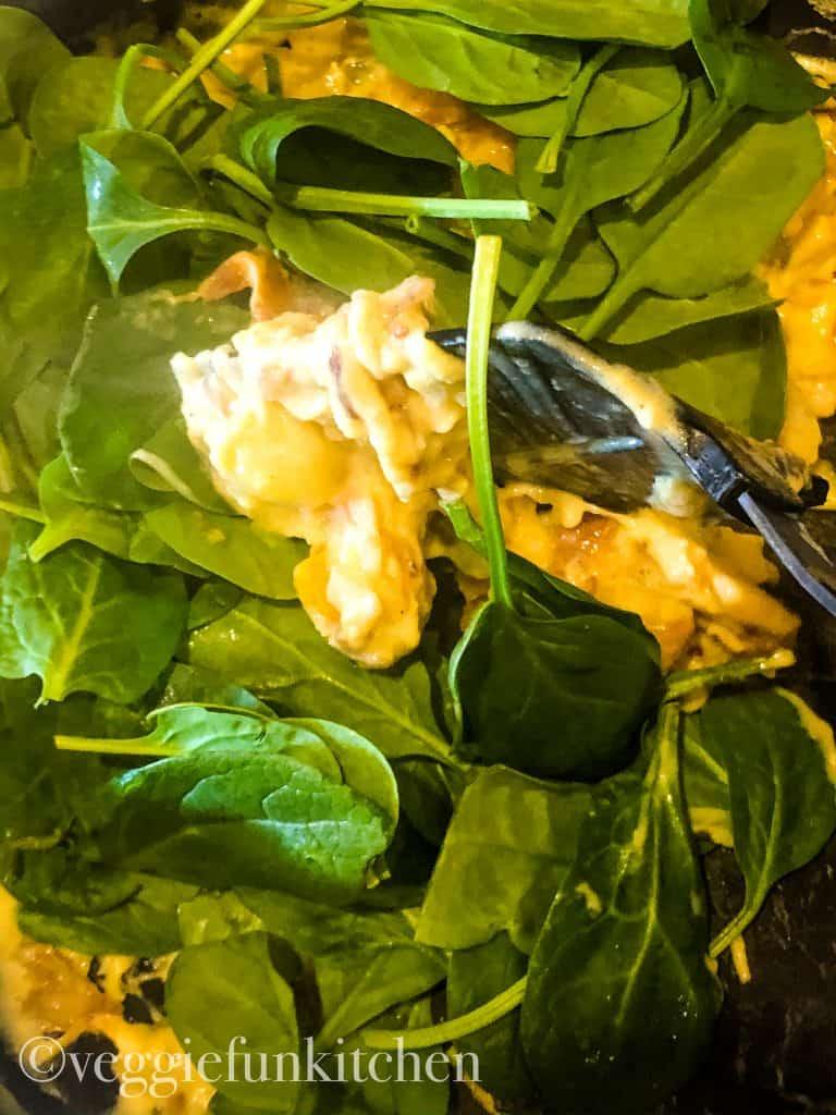 adding spinach to vegan egg scramble