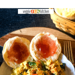 vegan breakfast scramble on plate with jammed biscuits on wooden platter with text overlay