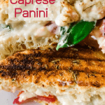 two halves of caprese panini sandwiches held in hand with text overaly