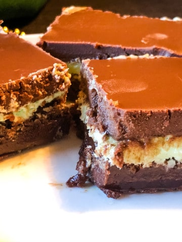 Three chocolate mint brownies on a plate