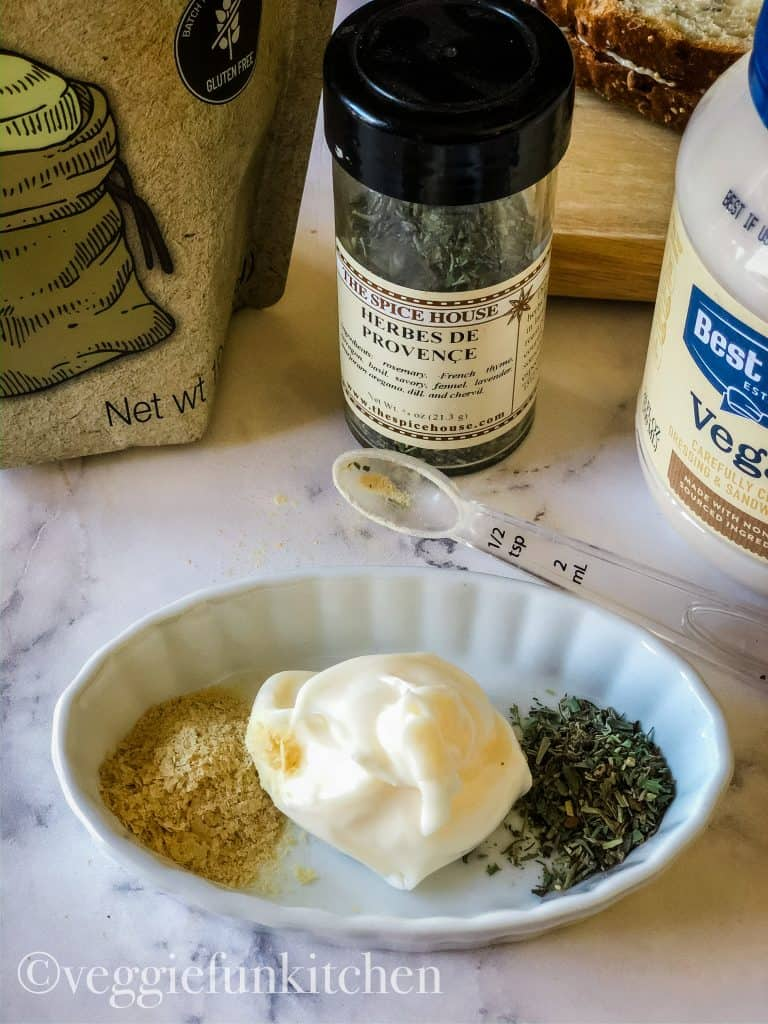 ingredients for herbed mayo including vegan mayo, nutritional yeast, herbes de provence