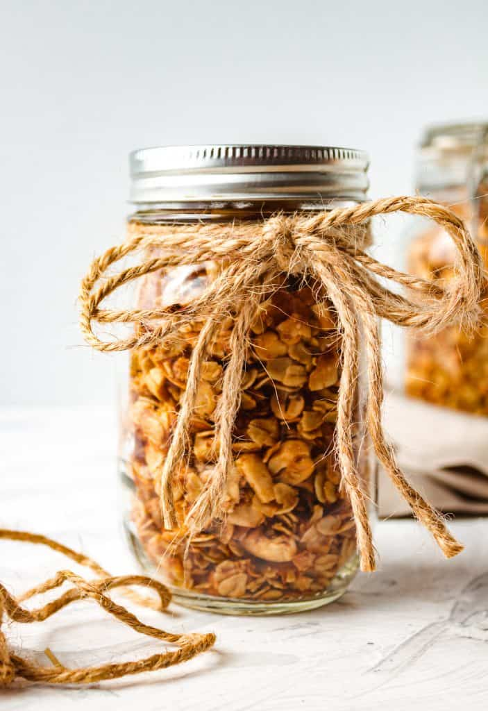 granola in glass jar with brown twin tied in a bow