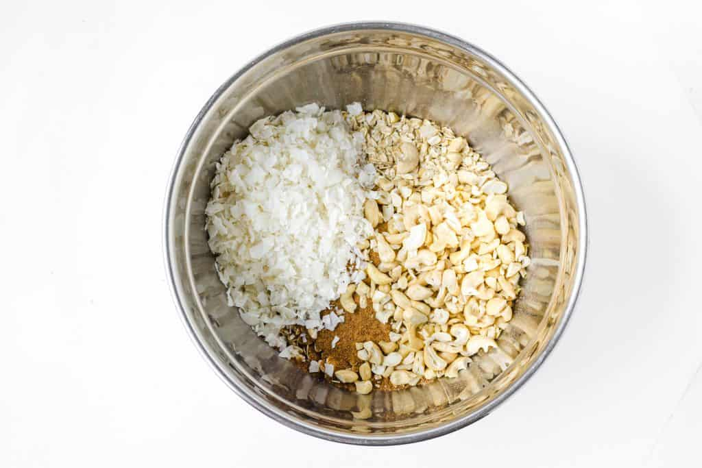 oats coconut and brown sugar in a metal bowl