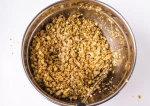 granola being mixed up in bowl