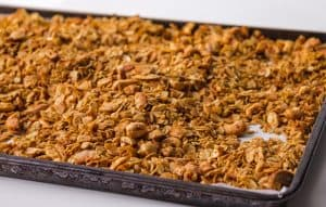 granola on pan with parchment