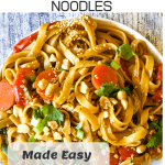 peanut butter noodles on white plate with Pinterest text overlay
