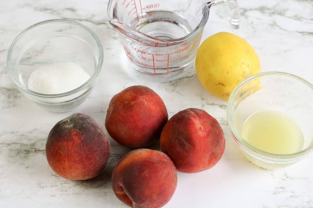 ingredients for peach sorbet including sugar, water, 4 peaches, lemon