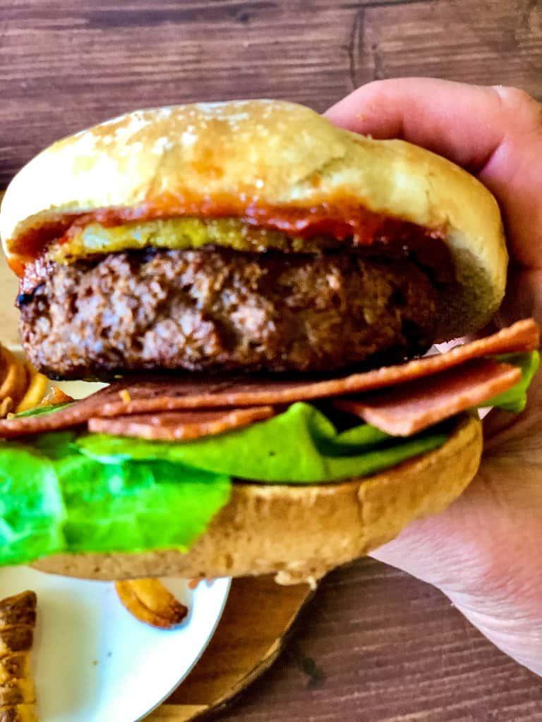 Hawaiian burger held in hand