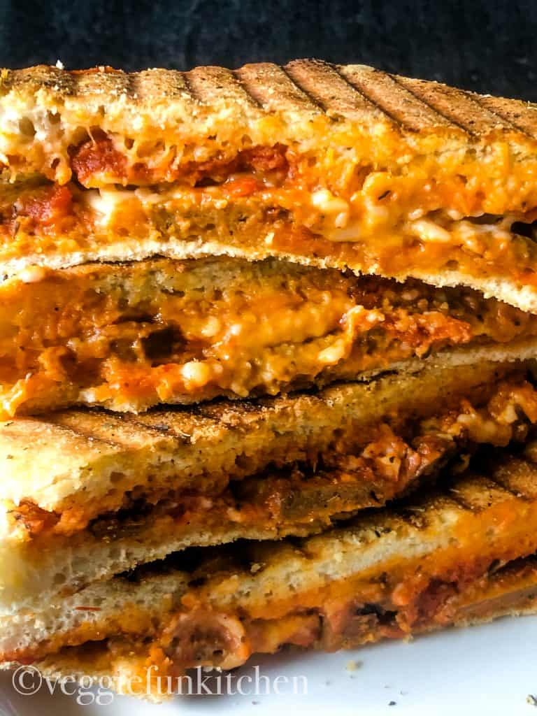 four pizza panini halves stacked