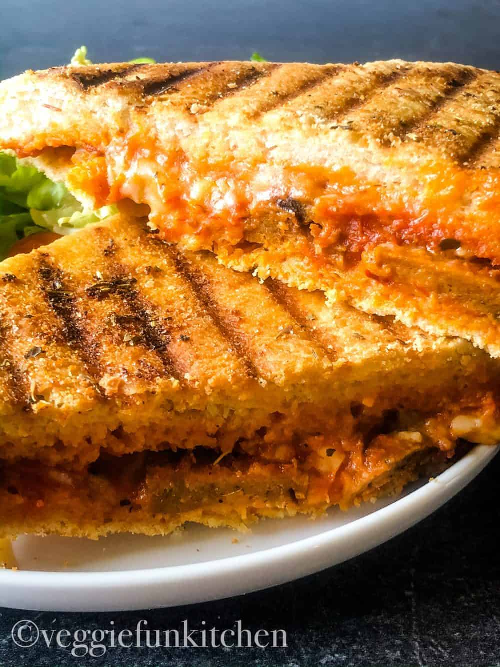 two pizza panini halves on white plate