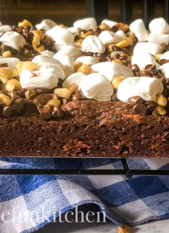uncut and out of pan, rocky road brownies on cooling rack