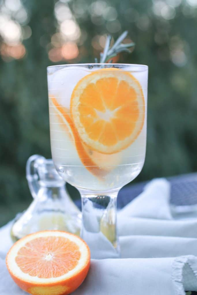 cirtrus champagne in stemmed glass with cut orange