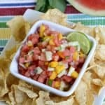 watermelon mango salsa in white bowl with chips