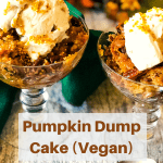 pumpkin dump cake in two glass goblets with vegan ice cream on top and seasonal decorations in background with pinterest text overlay
