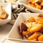 roasted butternut squash and cauliflower in white square dishes