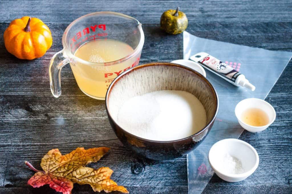 ingredients needed for aquafaba meringues including aquafaba, sugar, cornstarch, cream of tartar, vanilla, black gel