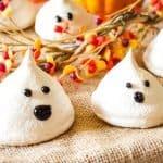 decorated ghostly vegan meringues on burlap