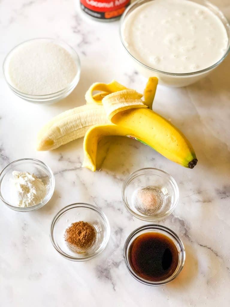 ingredients needed for sweet cream ice cream including cornstarch, sugar, coconut milk, banana, salt, nutmeg, and vanilla