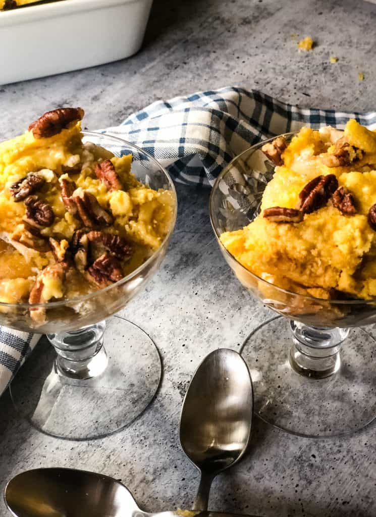 two fancy crystal goblets with sour cream apple pie dump cake