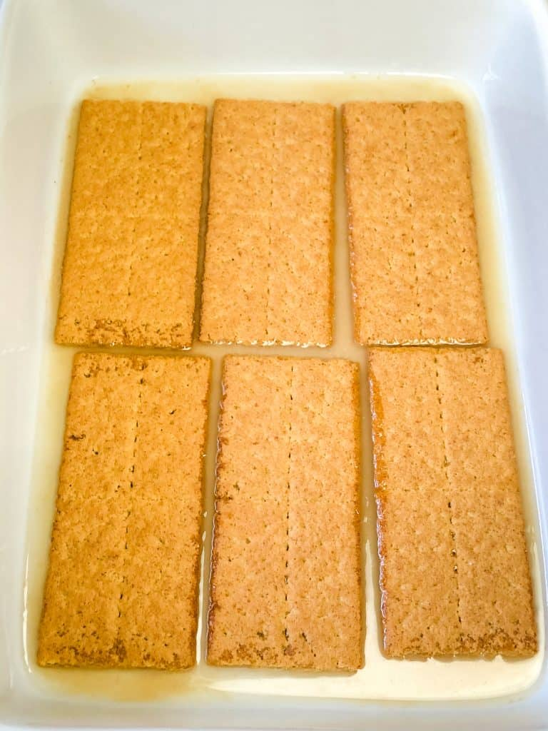 six graham crackers in pan with a little melted butter on the bottom