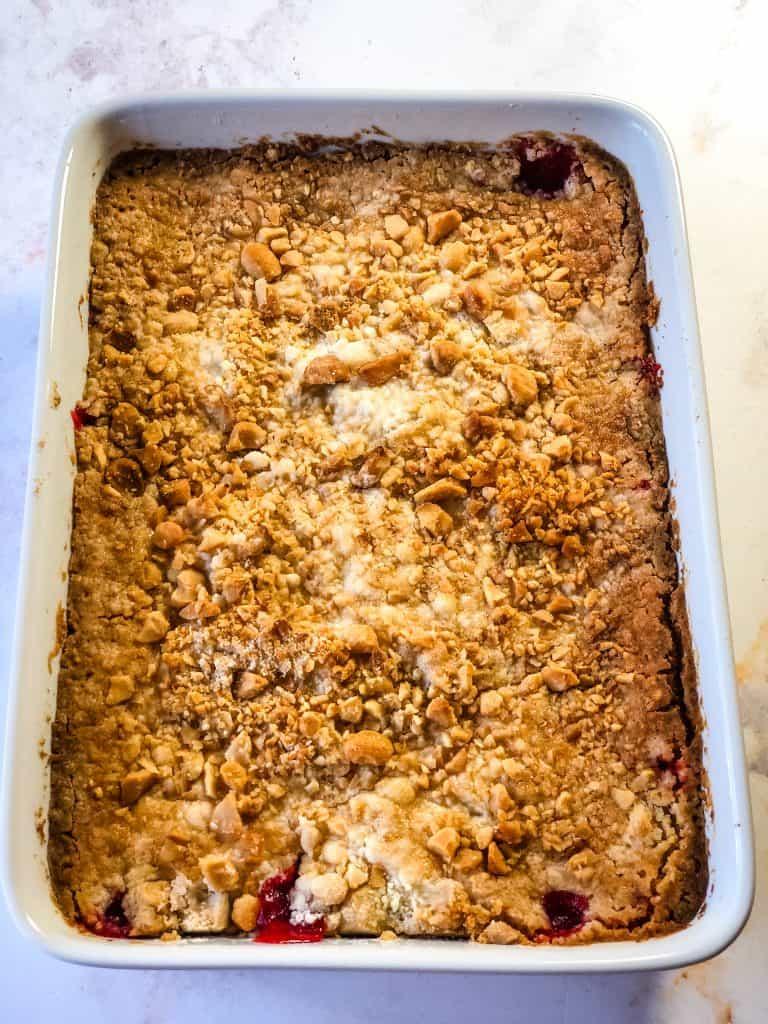 baked cherry cheesecake dump cake showing lovely golden brown baked finish