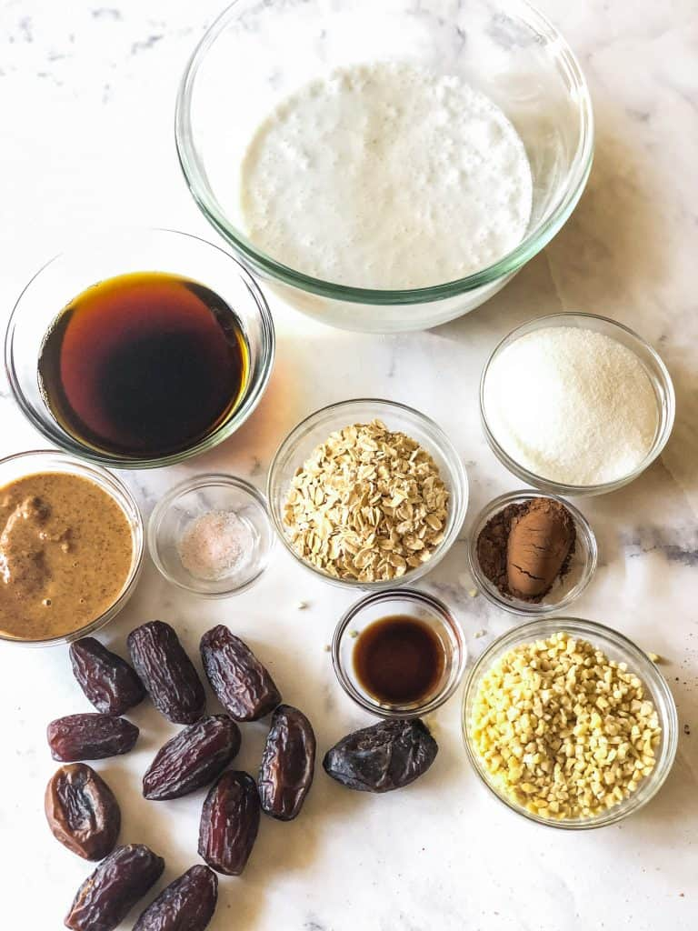 ingredients for chocolate almond ice cream including almond butter, Medjool dates, coffee, oats, coconut milk, sugar, cocoa powder, vanilla and nuts