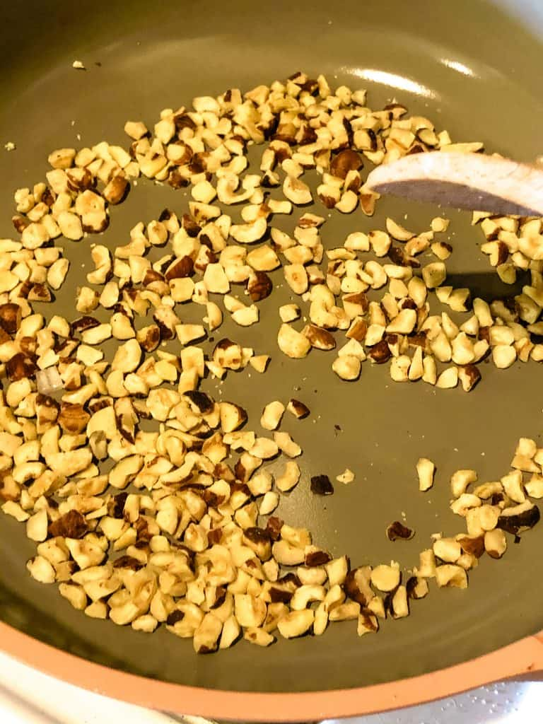 toasting chopped hazelnuts in dry pan