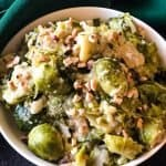 bowl of instant pot brussels sprouts topped with hazelnuts
