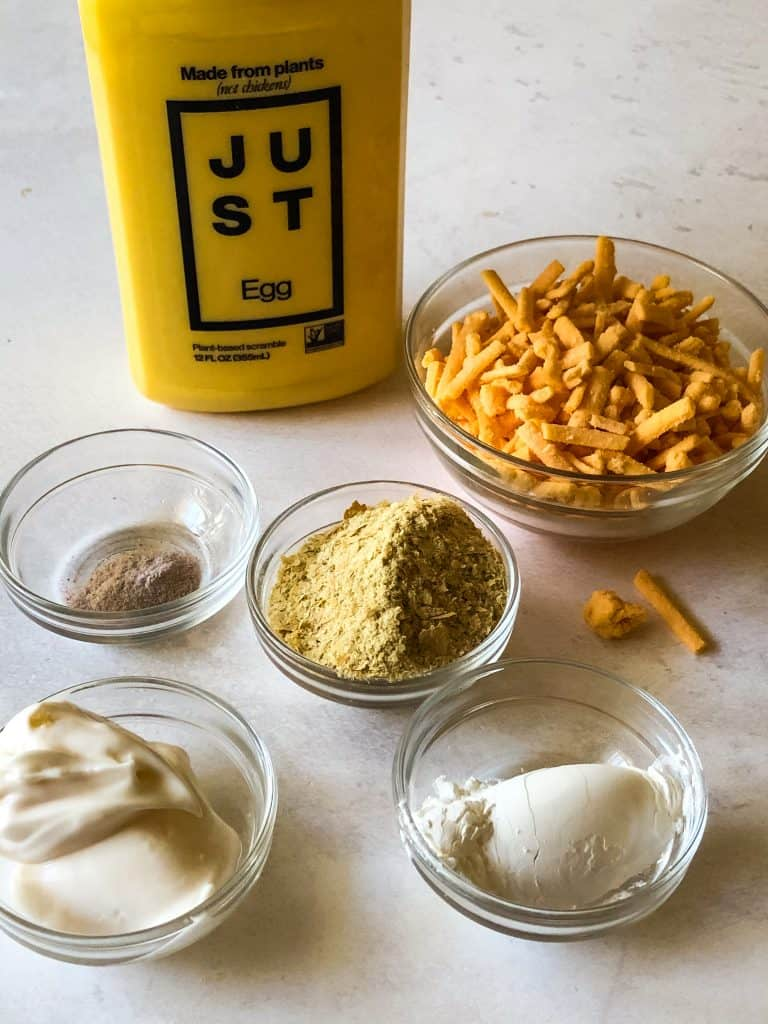wet ingredients for hash brown casserole including JUST Egg, vegan mayo, cornstarch, nutritional yeast, black salt, and vegan shredded cheese