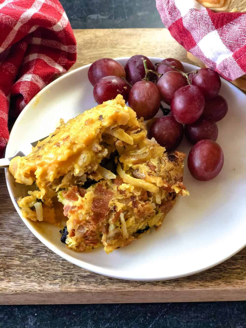 hash brown casserole on plate with grapes