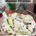 mashed potatoes in glass dish with slow cooker in background with pinterest text overlay
