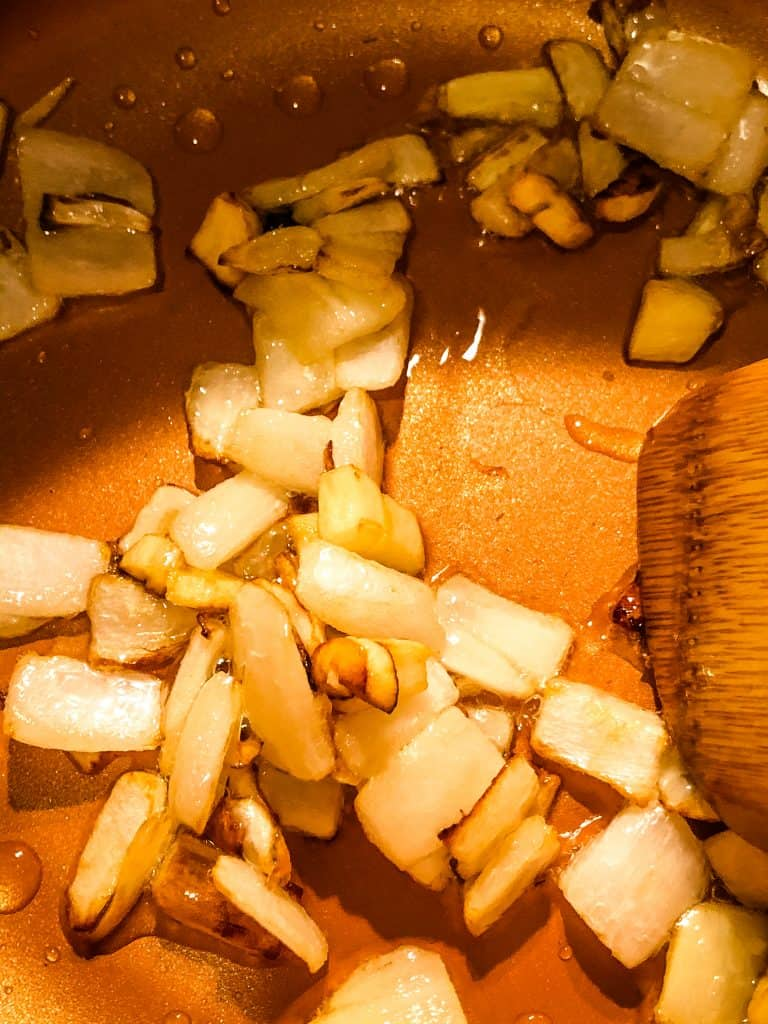 onions and garlic sauteing in pan