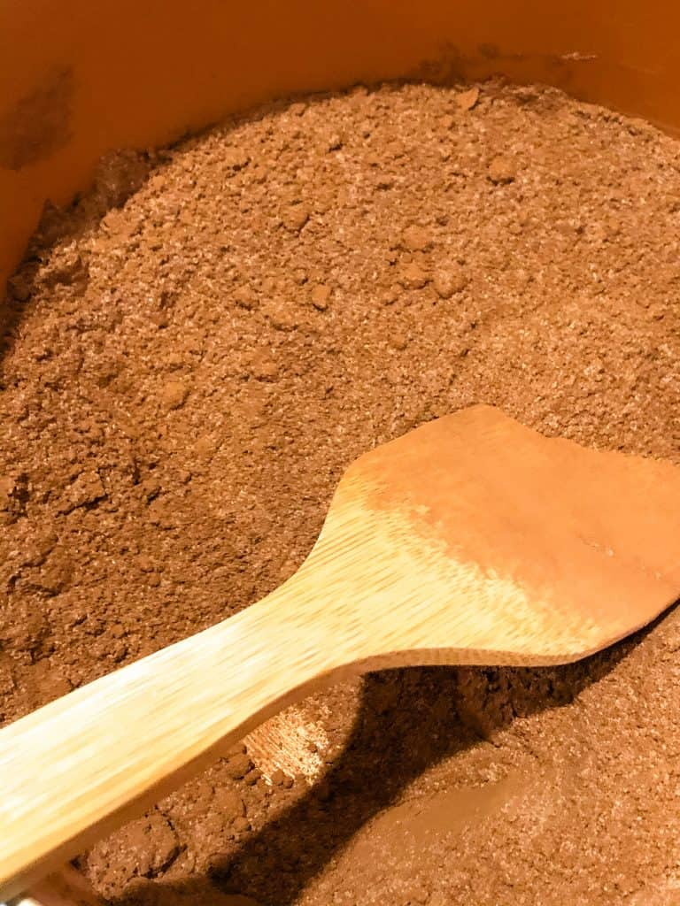 mixing together the sugar and cocoa powder