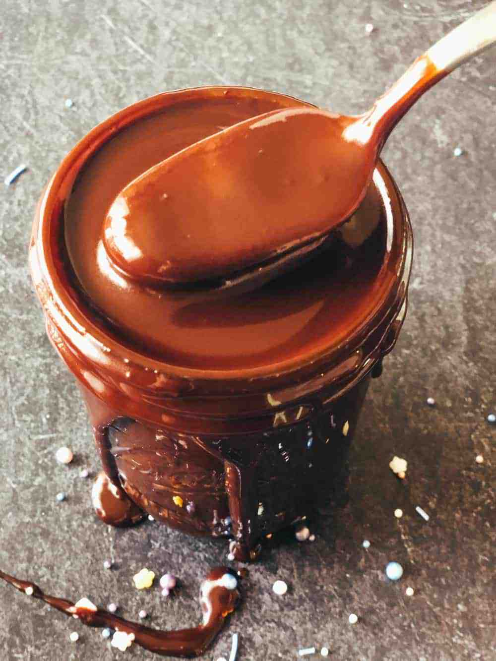 spoon dipping out portion of chocolate sauce