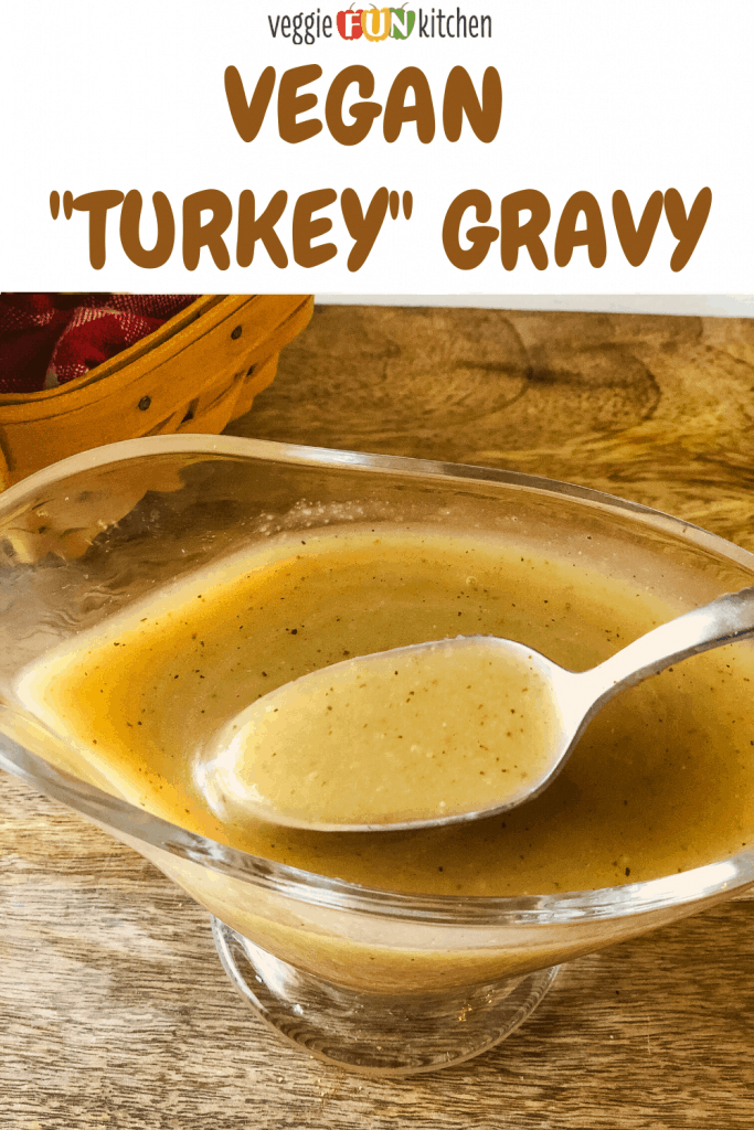 turkey gravy in glass gravy boat with a spoonful being dipped out with pinterest text overlay