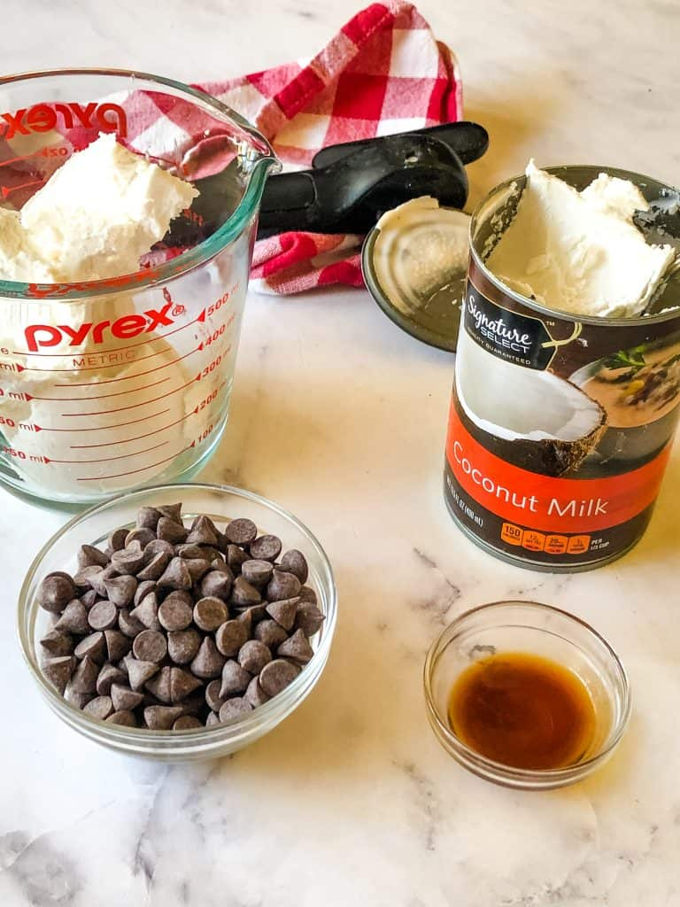 ingredients needed for vegan ganache including coconut cream, chocolate chips, and vanilla