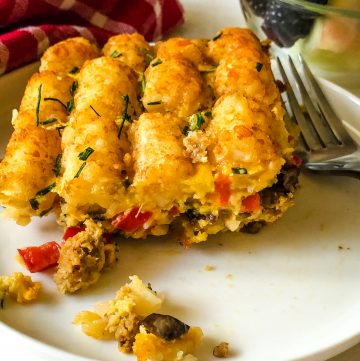 tater tot breakfast casserole with bowl of fruit