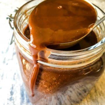 Jar of homemade vegan chocolate liqueur.
