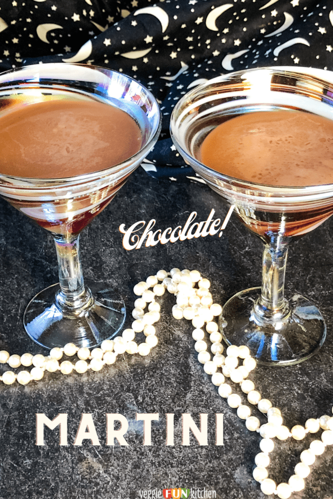 Two elegant martini glasses filled with chocolate martinis made with vegan chocolate liqueur with stars and moon backdrop and white beads in forefront all with pinterest text overlay