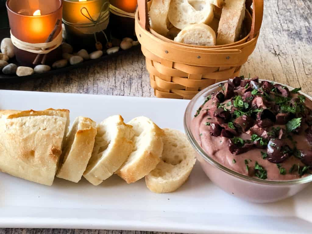 olive tapenade with cut bread on the side