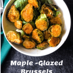 bowl of maple glazed Brussels sprouts with pinterest text overlay
