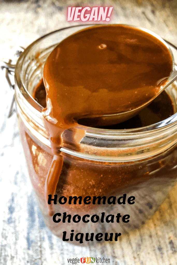 Jar of homemade vegan chocolate liqueur with Pinterest text overlay.