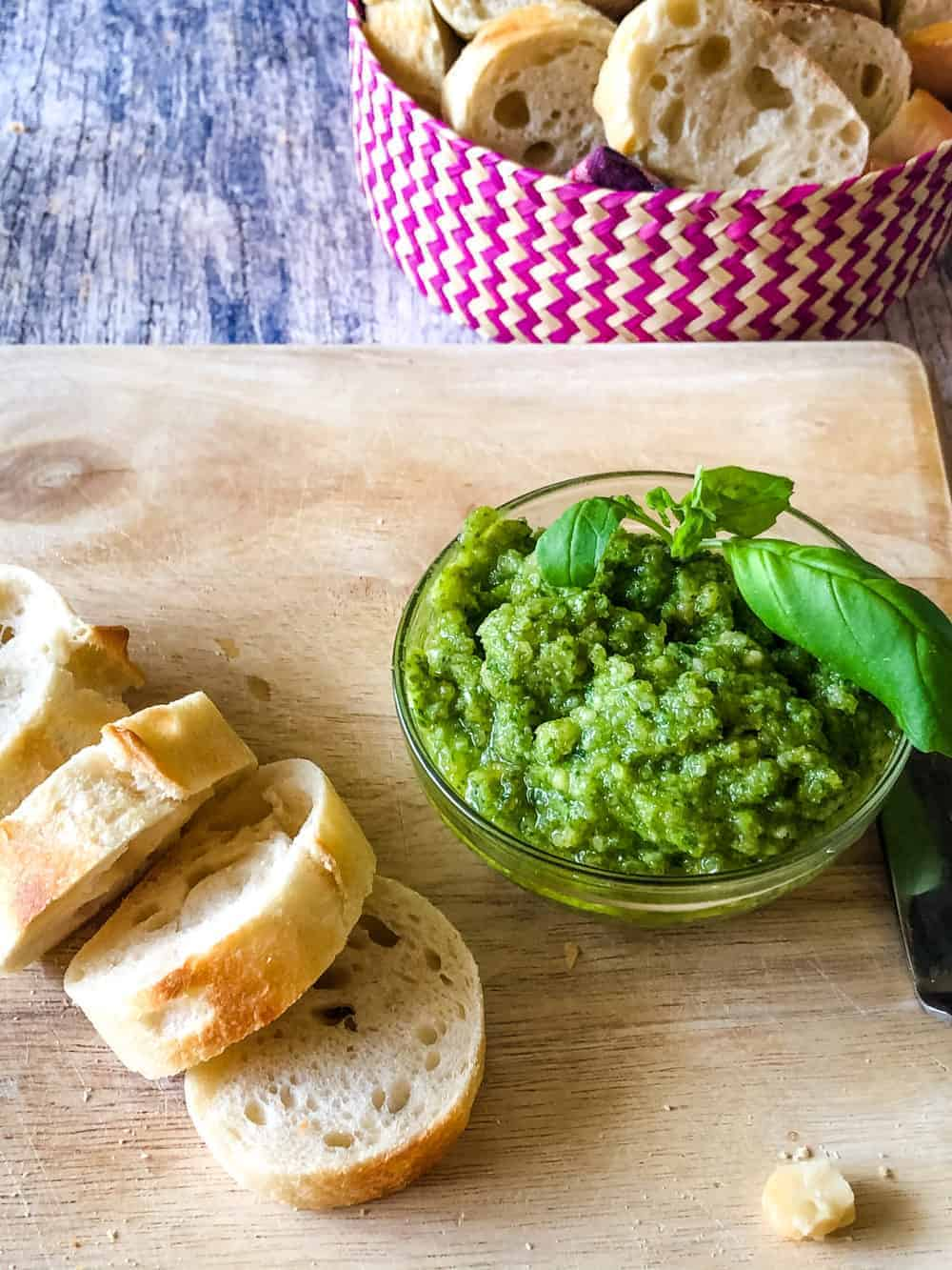 macadamia nut pesto in bowl with sliced bread