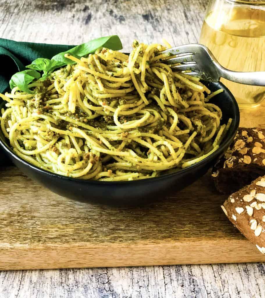 bowl of angel-hair spaghetti tossed with pistachio pesto