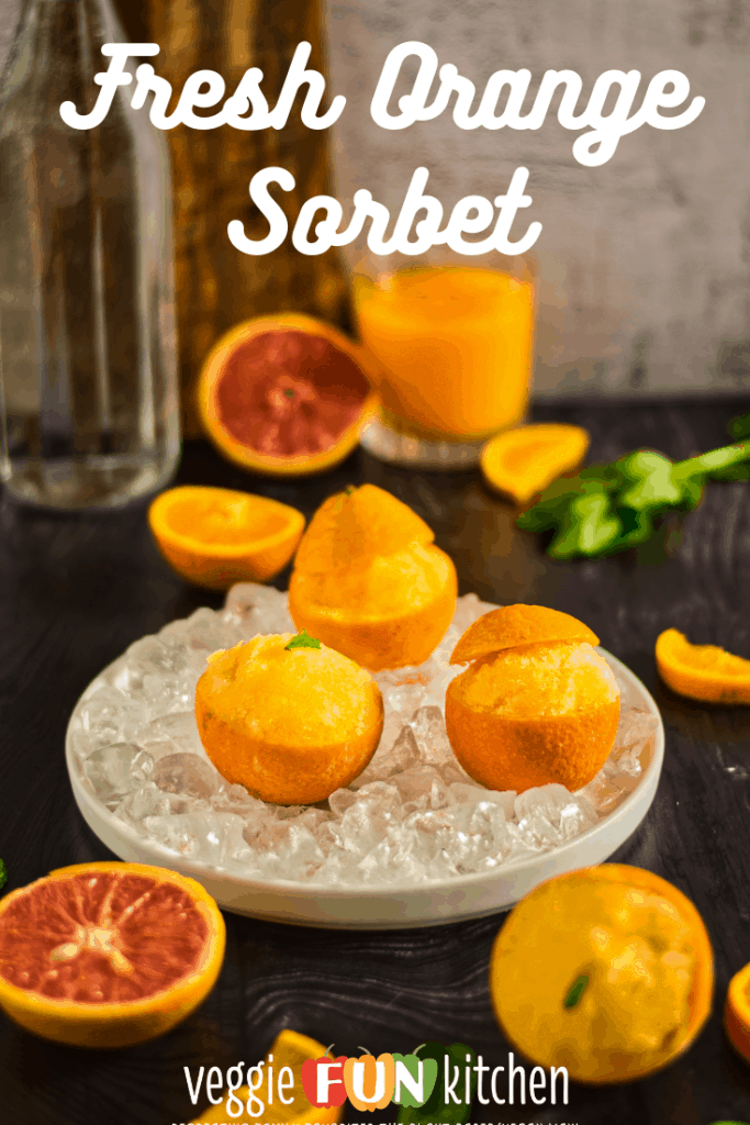 orange sorbet in orange peels in an iced dish with a glass container in the background with pinterest text overlay
