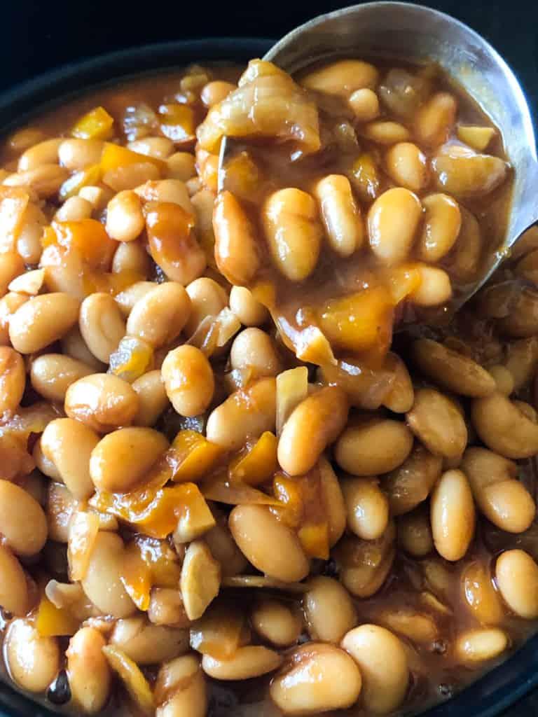ladling the baked beans
