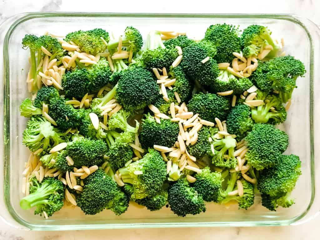 cut broccoli and slivered almonds in a prepared casserole dish