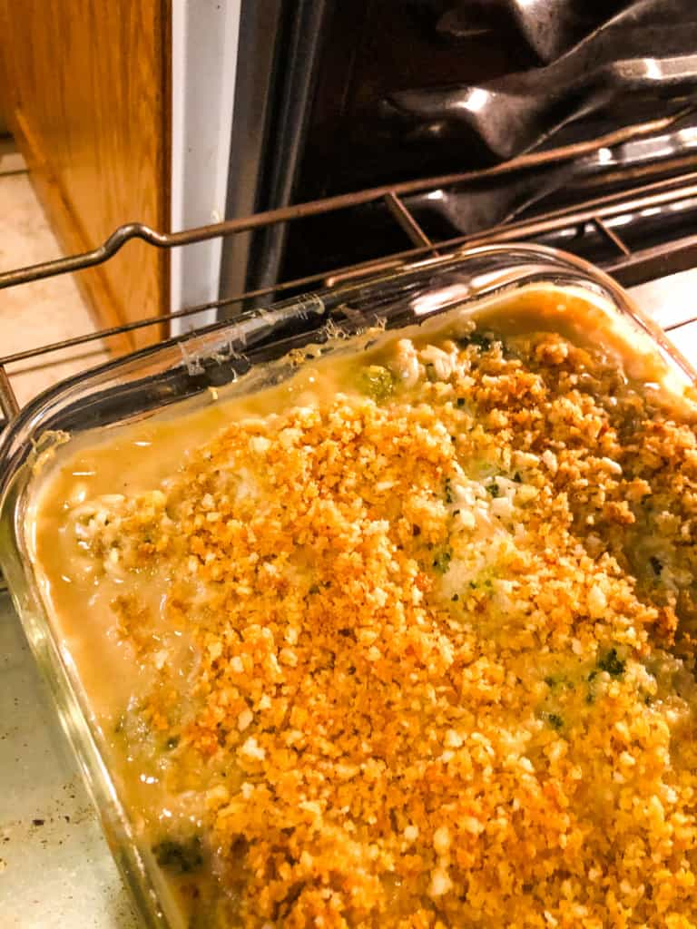 Broccoli Rice Casserole being placed in the oven