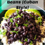 Cuban black beans over rice with limes on the side and cilantro on top with pinterest text overlay